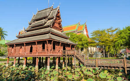 Thai wooden temple of  Wat Thung Si Muang in Ubon Ratchathani, Thailand