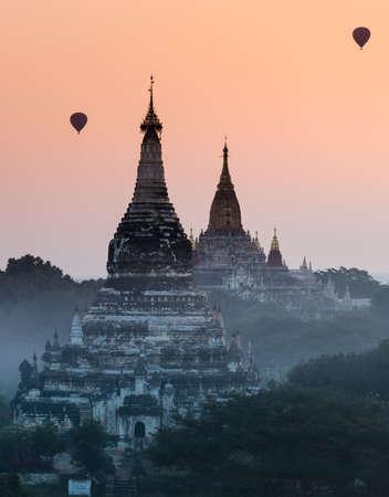 Bagan at sunrise with hot air balloon, Myanmar  photo