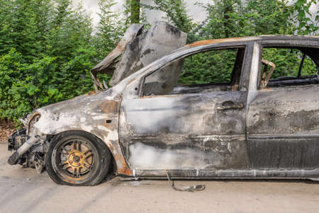 burnt out: Burnt out car wreck after a fire