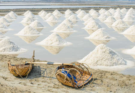 Heap of sea salt in evaporation pond, Thailand photo