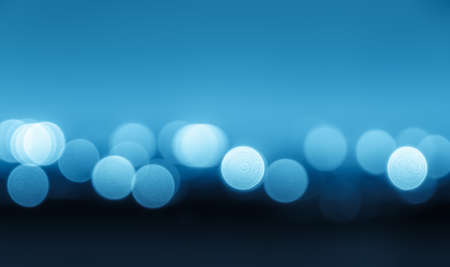 Blurred bokeh blue city lights background photo