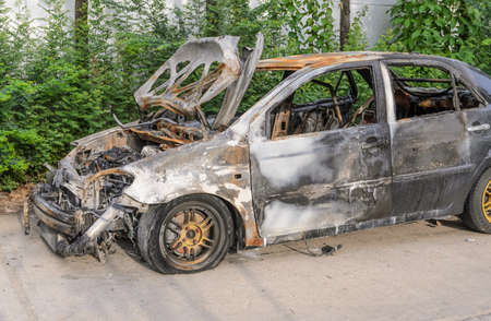 explosion engine: Burnt out car wreck after a fire