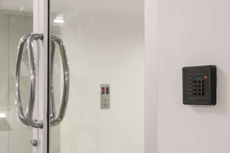 the reader: Door access control keypad with keycard reader Stock Photo