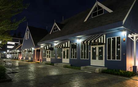 Stunning view of Dutch style house illuminated at night