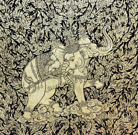 Ancient Thai gold leaf painting art of three head elephant on temple door, Thailand photo