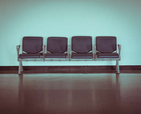 Empty seat at the airport in retro style photo