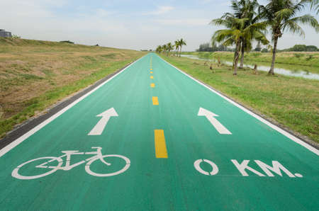 Green road with white bicycle sign photo