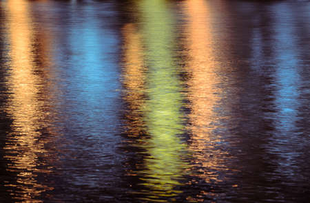 Colorful lights reflection on the water photo