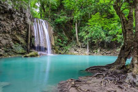 Beautiful deep forest waterfall of Erawan waterfall in Kanchaburi, Thailand photo