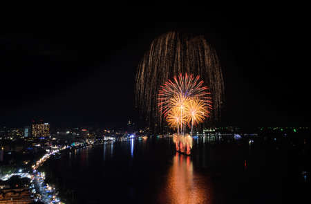 Aerial view of Pattaya city with firework at beach, Thailand photo