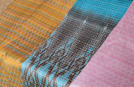 Thai silk fabric pattern background photo