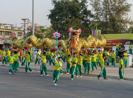 NAKHONSAWAN,THAILAND - FEBRUARY 13: Chinese New Year parade on February 13, 2013 in Nakhonsawan, Thailand. Chinese dragon dance performance for Chinese New Year Celebrations.