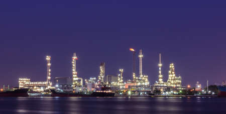 Oil refinery plant illuminated at twilight in Bangkok, Thailand photo