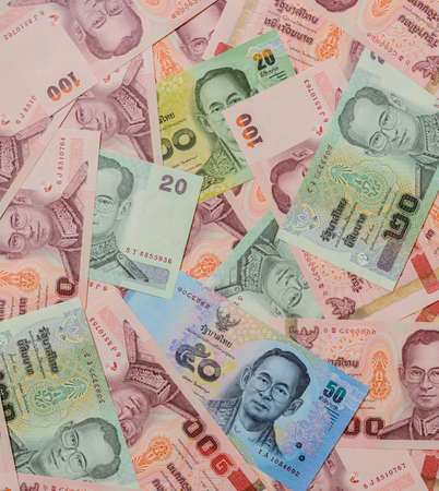 Thailand currency of Baht banknotes background photo