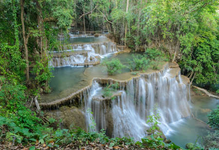 Huay Mae Khamin Waterfall, Paradise waterfall in Tropical rain forest of Thailand photo