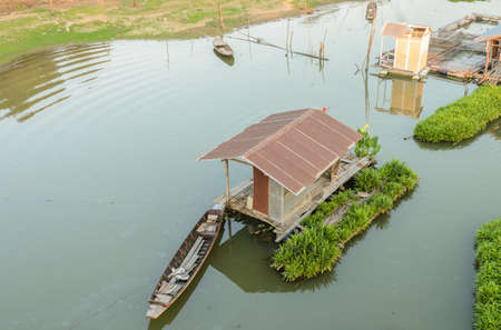thani: Floating wooden house with boat in Uthai Thani, Thailand