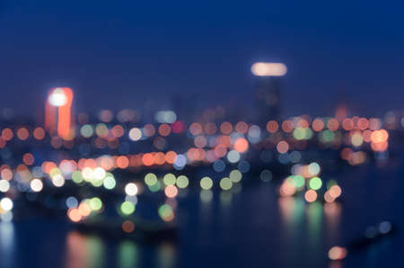 Blurred city lights bokeh illuminate at night photo