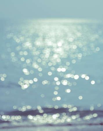 Abstract nature sea - blurred sunset of sea beach photo