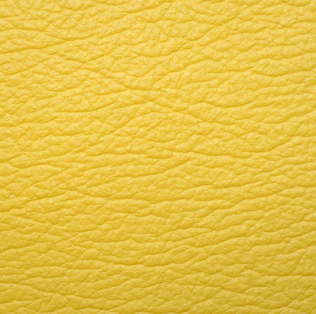 Bright yellow leather texture background photo