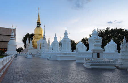 white washed: Golden pagoda and group of white washed mausoleums at Wat Suan Dok temple in Chiang Mai , Thailand