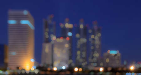 Bangkok skyline at night with reflection on water - Blurred bokeh background photo