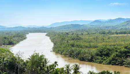 isthmus: Aerial nature view of Kho Khot Kra or Kra Isthmus. The Kra Isthmus is the Malayan Peninsula narrowest point. Kra Buri River forming a natural boundary between Thailand and Myanmar.