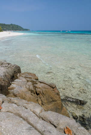 Beautiful white sand beach and crystal clear water of Koh Tachai Similan National Park Thailand photo