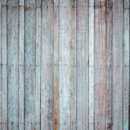 hammered: Rough wooden wall with the hammered rusty nails background Stock Photo