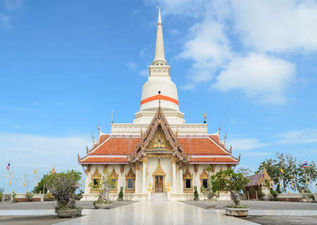 Buddhist temple with white pagoda in Thailand photo