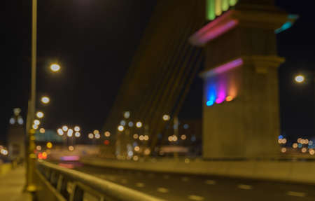cable bridge: Blurred image of cable bridge at night with bokeh