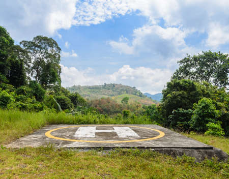 helicopter pad: Helicopter pad on peak of mountain with cloud sky Stock Photo