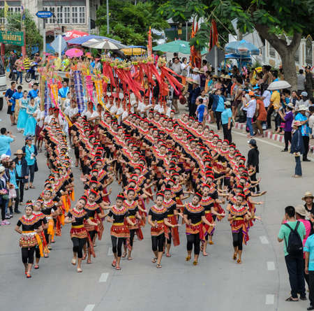 thai dancing: SUPHANBURI, THAILAND - JULY 12, 2014: Thai dancing parade of candle festival procession on The Buddhist Lent Day in Suphanburi, Thailand. Editorial