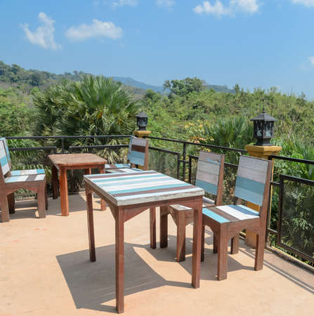 patio furniture: Outdoor deck and patio furniture with mountain view. Southern Thailand