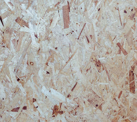oriented: Recycled compressed wood particle board background, texture of oriented strand board (OSB)