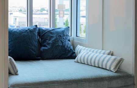 living room window: Living room with  cushions and glass window