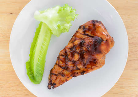 chicken breast: BBQ Chicken Breast with vegetable on white plate