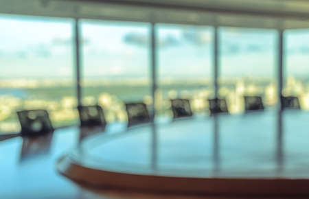 office space: Blur image of empty boardroom with window cityscape background. Business concept