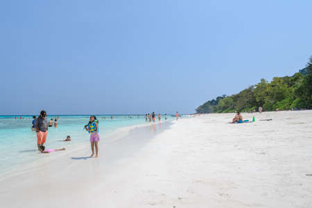 phangnga: Phang Nga, Thailand-FEBRUARY 15, 2015 : Tourists at crystal clear water as emeral and white sand beach of Tachai island in Phang-nga, Thailand.