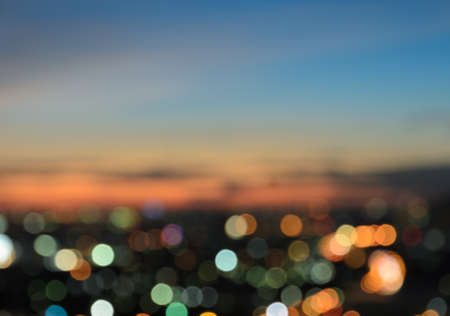 bokeh lights: Blurred twilight sky background with colorful city lights bokeh