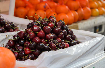 sidewalk sale: Cherry fruits for sale at market in Chinatown, Thailand Stock Photo