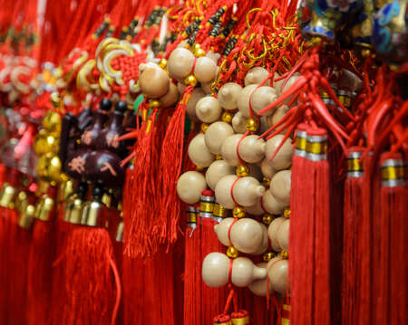 lucky charm: Good luck item for sale in a market during Chinese New Year festival in Thailand
