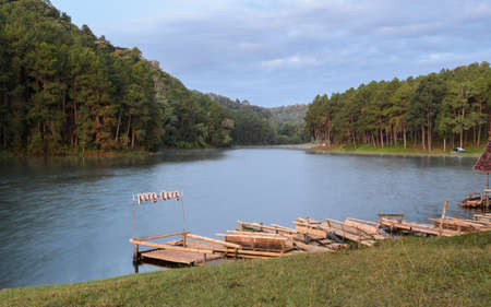 thailand bamboo: Pang Oung, a serene lake in a valley with surrounded by mountain ranges in Mae Hong Son, Thailand. Bamboo raft for sightseeing around the lake Stock Photo