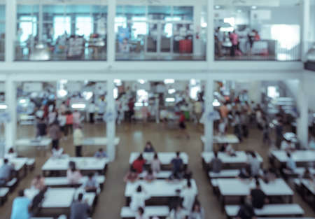 food court: Blur abstract backgroud of cafetaria in University or food court in shopping mall. Vintage style color effect.