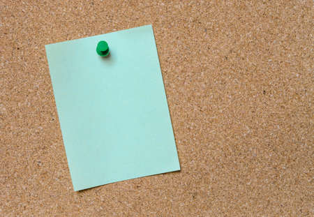 tack board: Blank green paper posted on cork board with green tack pin for text and background