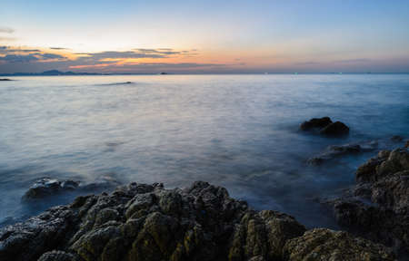 afterglow: Rock beach sunset skyline afterglow Stock Photo
