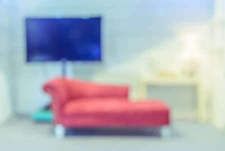 red couch: Blurred Modern Living Room with red couch background