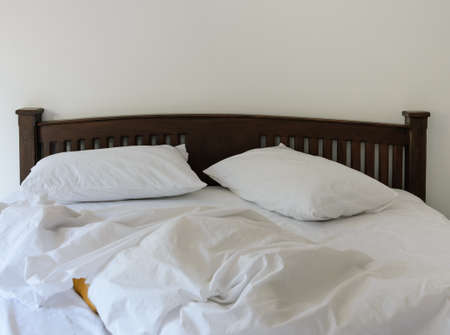 unmade: Morning view of an unmade bed in white bedroom