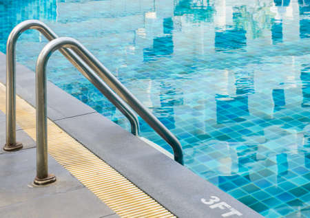 metal handrail: Swimming pool with metal handrail stair Stock Photo