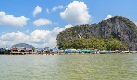 Landscape of limestone karsts of Phang Nga Bay National Park.  Panyi island or Koh Panyee, floating fishing village in Phang Nga Province, Thailand