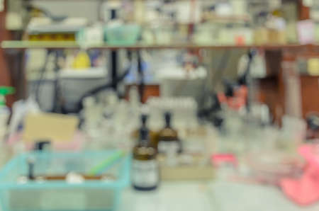 untidy: Blurred abstract background of untidy workbench in chemistry laboratory